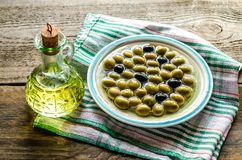 Olive oil and whole olives Stock Photos