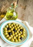 Olive oil and whole olives Stock Images