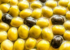 Olive oil and whole olives Royalty Free Stock Photos
