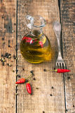 Olive Oil With Chili Peppers Stock Image