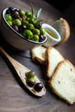 Olive oil on wood Stock Photography