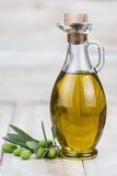 Olive oil on a wooden background Stock Photography