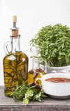 Olive oil tomato sauce and herbs Royalty Free Stock Photography