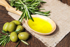 Olive oil in a wooden spoon Stock Photo