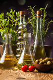 Olive oils in bottles with ingriedients Royalty Free Stock Photos