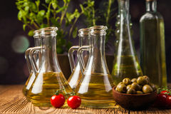 Olive oils in bottles with ingriedients Stock Photography