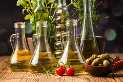 Olive oils in bottles with ingriedients Royalty Free Stock Photography