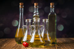 Olive oils in bottles with ingriedients Royalty Free Stock Images