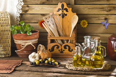 Olive oils in rustic kitchen Royalty Free Stock Images