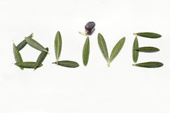 Olive and olive letters with leaves Stock Image