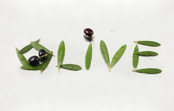 Olive and olive letters with path. Olive letters made with olive oil and olive leaves Stock Image