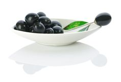 Olive On A Plate With Skewer Stock Image