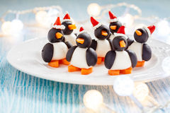 Olive penguins snack with santa hat Royalty Free Stock Images