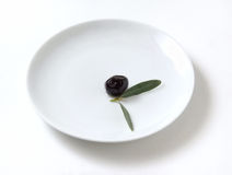 Olive in plate Stock Image