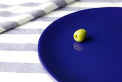 Olive on the plate. Olive on a dark blue plate.Greek still life Stock Images