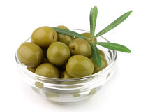 Olive on plate with branches Stock Images