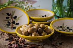 Olive plates Stock Images