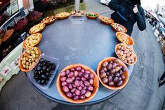 Olive samples on market in Brussels. A stand with olives offering samples in a food market in Brussels Belgium Royalty Free Stock Photos