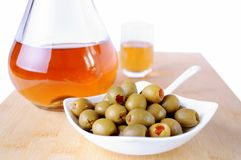 Olive and schnapps bottle Stock Photo