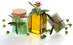 Olive soap and bath salt and oil with green olives Royalty Free Stock Images