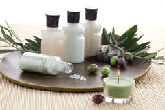 Olive Spa Set. Spa set - fresh olive twigs with fruits, organic olive bath salt, lotions, and aromatic candle. Best suited for relaxing and health commercials Royalty Free Stock Image