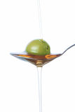 Olive on the spoon, with oil. Royalty Free Stock Photography