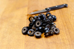 Olive sul tagliere Fotografia Stock