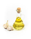 Olive or sunflower oil in bottle and garlic Stock Image