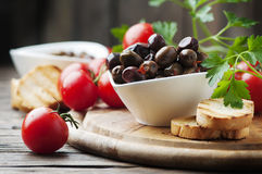 Olive with tamato and parsley on the wooden table Royalty Free Stock Photography