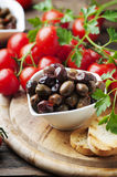 Olive with tamato and parsley on the wooden table Royalty Free Stock Photos