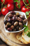 Olive with tamato and parsley on the wooden table Royalty Free Stock Photo