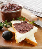 Olive tapenade of black olives with herbs Stock Images