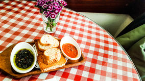 Olive and tomato paste served with breads at restaurant. Stock Photo
