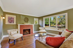 Olive tone family room with fireplace royalty free stock photos