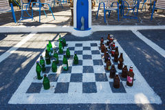 Olive Tree roadside cafe, Crete. Zenia, Greece - October 15 2016: Chess board on the pavement in the Olive Tree roadside cafe on the serpentine road to the Stock Image