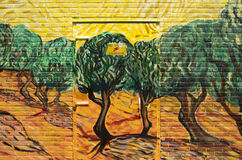 Olive trees with yellow sky and sun from Vincent van Gogh. Stock Photography