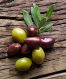 Olive twig and olives on old wooden table. royalty free stock image
