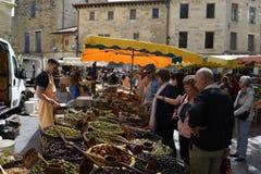 Olive vendor Sunday market L`Isle-sur-la-Sorgue, France stock images
