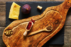 Olive wood cutting board with spices and fig Stock Image