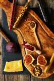 Olive wood cutting board with spices and fig. Over slate Stock Image