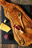 Olive wood cutting board with spices and fig Royalty Free Stock Photo