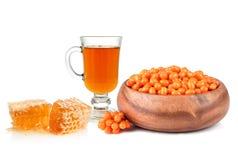 Olivello spinoso, tè e miele Immagine Stock