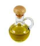 Olivenöl in einer Flasche auf Weiß Stockfotos
