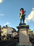 Oliver Cromwell with poppy necklace. Statue of Oliver Cromwell on Rememberance day 2018 in St Ives Cambridgeshire with poppy wreath royalty free stock photos