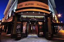 The Oliver Plunkett pub in Cork. He Oliver Plunkett pub outside by night, Cork downtown, Ireland Royalty Free Stock Image