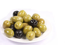 Olives. Black and green olives on plate Royalty Free Stock Image