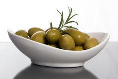 Olives 2. A small bowl full of green olives with a reflection of the bowl in the foreground Stock Photography