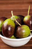 Olives. Black/green olives over a wooden table Stock Photo