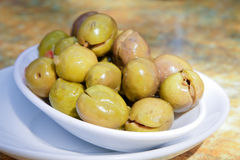 Olives. In a white plate Stock Photos
