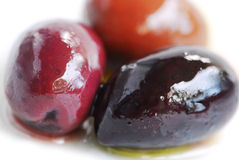 Olives. Macro image of greek kalamata olives and olive oil Stock Photography